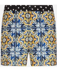 Dolce & Gabbana Medium Swimming Shorts With Maiolica Print On A Blue Background - Blau