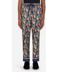 Dolce & Gabbana Silk Pajama Pants With All-Over Dg Print - Bleu