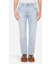 Dolce & Gabbana Light Blue Slim-Fit Stretch Jeans With Stitched Rips - Blau