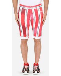 Dolce & Gabbana Stretch Denim Bermuda Shorts With Brushstroke Print - Red