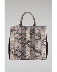 Dorothee Schumacher | Patched Perfection Patched Snake Neoprene Bag With Black Calf Suede | Lyst