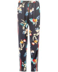 Dorothy Perkins - Navy Tropical Print Side Striped Joggers - Lyst