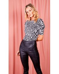 AX Paris Zebra Printed Puff Sleeve Bodysuit. - Black