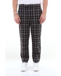Neil Barrett Pantalon à carreaux avec poche française - Noir
