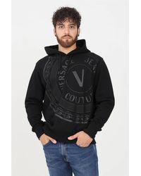 Versace Jeans Couture - Felpa uomo nero con cappuccio e stampa logo frontale - Lyst
