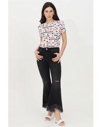 ViCOLO Jeans donna a zampa con leggere abrasioni e tagli sul fronte. vita alta passanti per cintura. fondo ampio sfrangiato - Nero