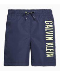 Calvin Klein Costume da bagno shorts con elastico regolabile in vita e logo verticale , composizione: 100& poliestere - Blu