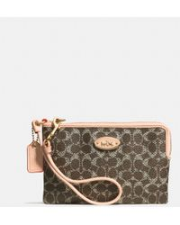 Coach Corner Zip Wristlet in Embossed Signature Canvas - Lyst