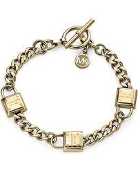 Michael Kors Gold Tone Padlock and Link Bracelet - Lyst