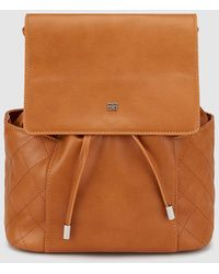 Gloria Ortiz - Kelly Camel Backpack With A Foldover Flap - Lyst