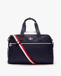 Lacoste Tricoloured Travel Bag Featuring Zip - Blue