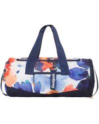 36b602a40211 Desigual - Tube Camo Flower Sports Bag - Lyst