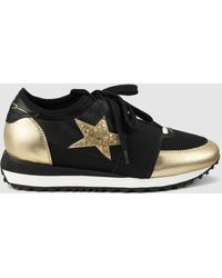 Lola Cruz | Black Leather Trainers With Gold Metallic Detail | Lyst
