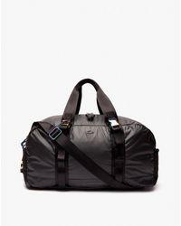 Lacoste Black Travel Bag Featuring Zip