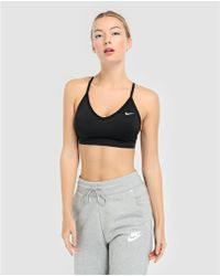 ea50770c431 Nike Seamless Light Sports Bra in Black - Lyst