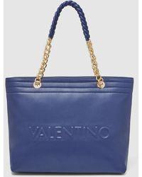 Valentino Shopping En Azul Marino Con La Marca En Relieve