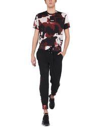 Dolce & Gabbana T-SHIRT GIROCOLLO IN COTONE CON STAMPA CAMOUFLAGE E PATCH LOGATA - Nero