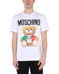 Moschino T-SHIRT GIROCOLLO IN COTONE CON LOGO E STAMPA ITALIAN TEDDY - Bianco