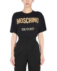Moschino T-SHIRT OVERSIZE FIT IN COTONE CON LOGO LAMINATO - Nero