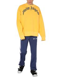 Palm Angels - Vintage Wash Curved Crew Neck Sweatshirt With Logo Print - Lyst