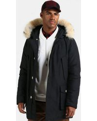 3995c40111e1 Lyst - Woolrich Arctic Parka in Black for Men