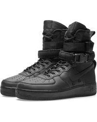 lyst nike sf air force 1 boot in nero per gli uomini.