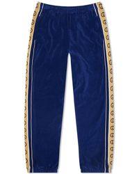 Gucci Tapered Logo-appliquéd Webbing-trimmed Piped Velvet Joggers - Blue