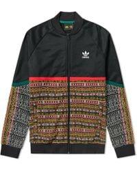 9696c07542 Adidas Originals Pharrell Williams Track Top in Black for Men - Lyst