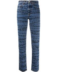Vetements Barbed Wire-print Slim-print Jeans - Blue