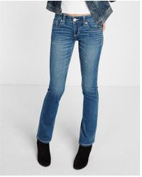 Express - Low Rise Thick Stitch Distressed Stretch Barely Boot Jeans, Women's Size:00 Short - Lyst