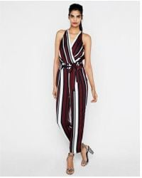 Express - Petite Striped Belted Surplice Jumpsuit - Lyst
