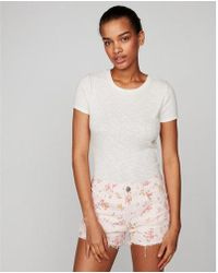 Express - High Waisted Floral Distressed Denim Shorts - Lyst