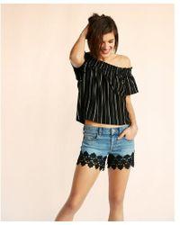 Express - Low Rise Vintage Lace Hem Denim Shorts - Lyst