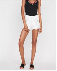 Express - High Waisted Raw Cut Lace Up Stretch Denim Shorts - Lyst