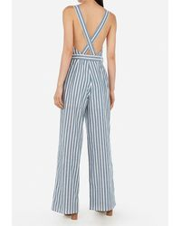 Express - Striped Cross-back Paperbag Waist Surplice Jumpsuit Blue Stripe - Lyst