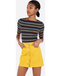 Express - High Waisted Snap Front Mini Skirt Yellow - Lyst