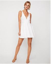 Express - Deep V-wire Fit And Flare Skort Dress - Lyst