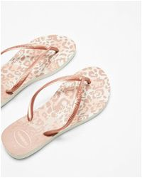 f7f084ff3072 Valentino By Havaianas Rockstud Camo-print Flip Flop in Yellow - Lyst