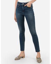 Express - High Waisted Denim Perfect Curves Lift Raw Hem Zip Ankle Leggings Blue - Lyst