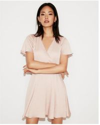 Express - Etite Satin Surplice Flutter Sleeve Fit And Flare Dress - Lyst