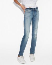 Express - Mid Rise Ripped Stretch+ Performance Skinny Jeans, Women's Size:00 Short - Lyst