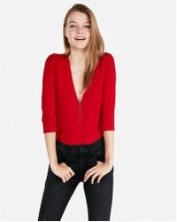 Express - Petite One Eleven Deep V Front Zip Thong Bodysuit - Lyst