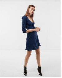 Express - Petite Deep V-neck Ruffle Hem Fit And Flare Dress - Lyst