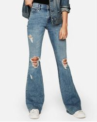 Express - Mid Rise Ripped Stretch Bell Flare Jeans, Women's Size:8 Short - Lyst