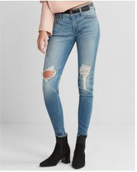 Express - Mid Rise Medium Wash Ripped Stretch Jeggings, Women's Size:4 - Lyst