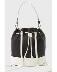 Elizabeth and James Perforated Cynnie Sling Bag black - Lyst
