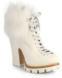Prada Lug-sole Leather  Fur Ankle Boots - Lyst