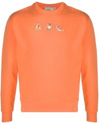"Maison Kitsuné Sweatshirt mit ""Yoga Fox""-Patches - Orange"