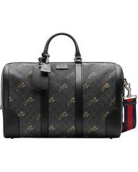 Gucci Reisetasche mit Logo-Print - Schwarz