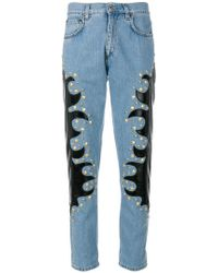Moschino - Studded Patch Straight Jeans - Lyst